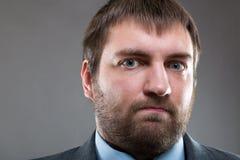 Poważny męski brodaty twarzy zakończenie w górę portreta Zdjęcie Stock