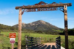 Signage at Entrance to Iron Mountain Trail in Poway, California. POWAY, CALIFORNIA - MARCH 16, 2017: Signage at the entrance to the Iron Mountain trail, with a stock image