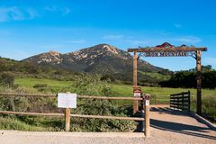 Wooden Fence and Trailhead Sign for Iron Mountain Trail. POWAY, CALIFORNIA - MARCH 16, 2017: Wooden fence and trailhead sign to the Iron Mountain trail, a royalty free stock photo