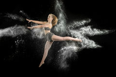 Powder. Artistic dance pose using powder Royalty Free Stock Photography