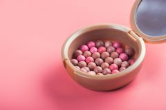 Powder balls and cosmetic brush. On pink background. beauty makeup product Stock Images