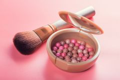 Powder balls and cosmetic brush. On pink background. beauty makeup product Stock Photos
