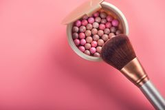 Powder balls and cosmetic brush. On pink background. beauty makeup product Royalty Free Stock Photography