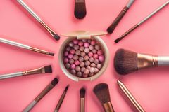 Powder balls and cosmetic brush. On pink background. beauty makeup product Royalty Free Stock Photo