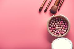 Powder balls and cosmetic brush. On pink background. beauty makeup product Stock Photography