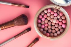 Powder balls and cosmetic brush. On pink background. beauty makeup product Stock Photo