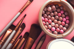 Powder balls and cosmetic brush. On pink background. beauty makeup product Royalty Free Stock Photos