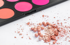 Powder in the balls with a radiant effect on the background of the set for blush. Make-up cosmetics, Stock Images