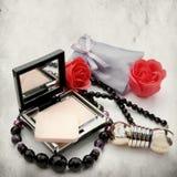 Powder-box and lipstick Stock Photography