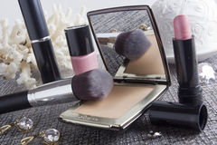 Powder box with mirror and cosmetic brush. Women's powder box with mirror and cosmetic brush make-up Royalty Free Stock Photos