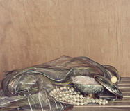Powder box, pearl bead and scarf Stock Photography