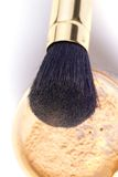 Powder brush. In golden case with loose powder Stock Photography