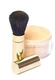 Powder brush. In golden case with loose powder Royalty Free Stock Photo