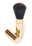 Powder brush. In golden metal case Royalty Free Stock Photography