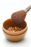 Powder and brush closeup Stock Photo