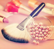 Powder and brush for makeup on the table. Vintage retro hipster Stock Photo