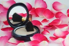 Powder and brush and rose petals Stock Photo