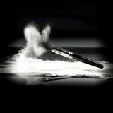 A powder brush and white loose powder Stock Photo