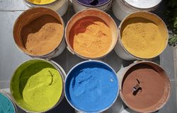 Powder coating cans. Various colors. Photographed on a sold out counter. Paint, box, colorful, dry, background, decoration, yellow, bright, red, texture, green royalty free stock photography
