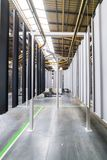 Powder coating line. Metal panels are suspended on an overhead conveyor line. royalty free stock image