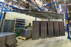 Powder coating line. Metal panels are suspended on an overhead conveyor line. royalty free stock photography