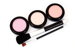Powder compact. Three different color powder compact - beauty treatment Royalty Free Stock Photo