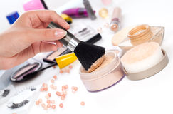 Powder with cosmetic brush. On table wit makeup Royalty Free Stock Photo