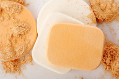 Powder and cosmetic sponges Stock Photography