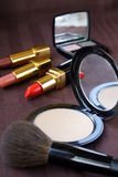 Powder cosmetics lipstick shade and brush Stock Photography