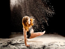 Powder dancer action. Dance expressive dance movement of a female contemporary dancer Royalty Free Stock Image