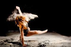Powder dancer expressive movement. Dance expressive dance movement of a female contemporary dancer Royalty Free Stock Image