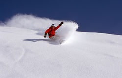 Powder day. Snowboarder is riding fresh powder on a perfect day Stock Photo