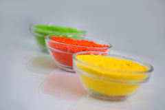 Powder of different colors for holi festival. Holi color powder in bowl royalty free stock image