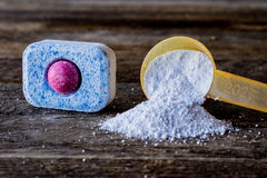 Powder for the dishwasher vs. tablet royalty free stock photos