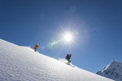 Powder downhill skiing Stock Images