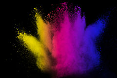 Powder explosion. Multicolored powder explosion on black background royalty free stock photo