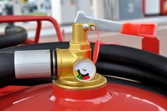 Powder fire extinguisher with pressure gauge Royalty Free Stock Photo