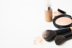 Powder, foundation and brushes on the white Royalty Free Stock Images
