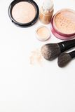 Powder, foundation and brushes on the white Stock Image