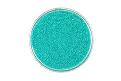 Powder green sand in a glass dish Stock Photos