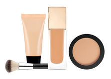 Powder, liquid makeup foundation in tube and brush isolated on w. Hite background Royalty Free Stock Photography