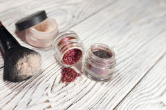 Powder, pigments, glitter, brushes and eyeliner. Collection of cosmetics for make-up artist. Powder, pigments, glitter, brushes and eyeliner. studio photo on a Royalty Free Stock Image