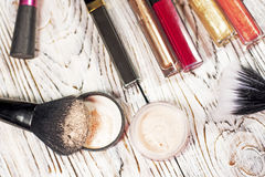 Powder, pigments, glitter, brushes and eyeliner. Collection of cosmetics for make-up artist. Powder, pigments, glitter, brushes and eyeliner. studio photo on a Stock Photos