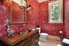 Powder room in luxury home. With red designed walls Royalty Free Stock Images