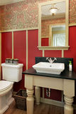 Powder room in luxury home. With red designed walls Royalty Free Stock Photography