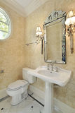 Powder room with sconces Royalty Free Stock Images