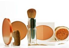 Powder, rouge, foundation and brushes Royalty Free Stock Photo