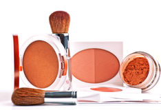 Powder, rouge, foundation and brushes Royalty Free Stock Photos