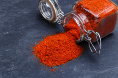 Powder seasoning spice paprika on a black stone Royalty Free Stock Photography