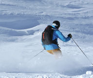 Powder skiing stock photography